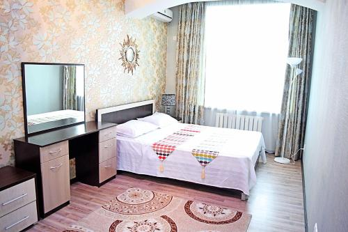A bed or beds in a room at Luxury Palace Apartment