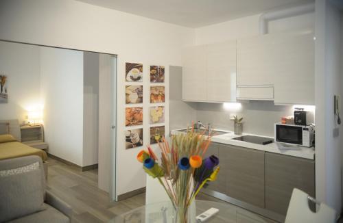 Cucina o angolo cottura di ANDREA LUXURY APARTMENTS - D'Azeglio
