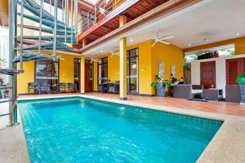 The swimming pool at or near Sunny Villa