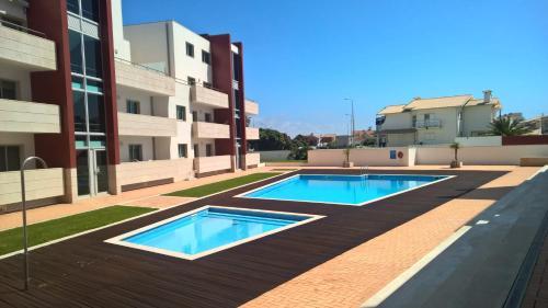 The swimming pool at or near Costa Nova Marina Apartment