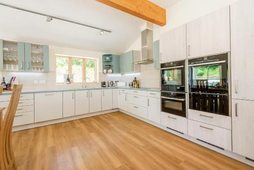 A kitchen or kitchenette at Wallops Wood Cottages