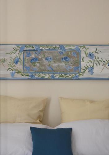 Ein Bett oder Betten in einem Zimmer der Unterkunft Casa Jolanda B&B