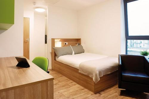 A bed or beds in a room at CityLiveIn London Wembley
