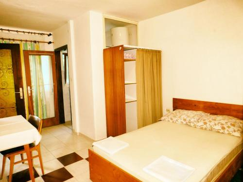 A bed or beds in a room at Apartment Niko ID:0008