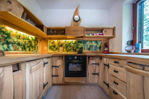 Kuchyňa alebo kuchynka v ubytovaní Oddy