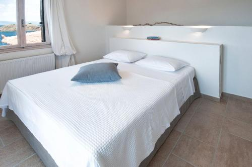 A bed or beds in a room at Little Bird Lesvos