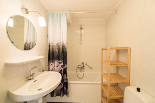 Een badkamer bij Kaap appartementen