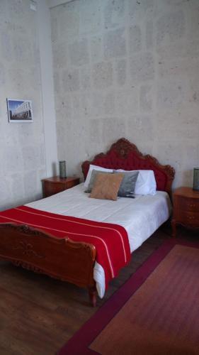 A bed or beds in a room at Casona de Asís