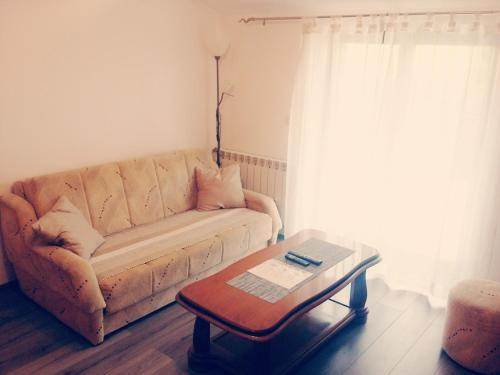 A seating area at Apartment Pejic 2