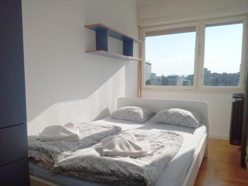 A bed or beds in a room at Apartment Love Zagreb