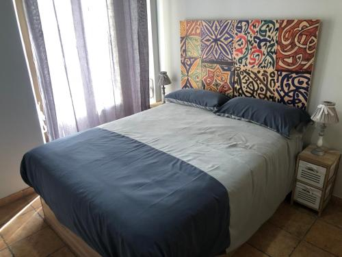 A bed or beds in a room at Apartament Turístic Tgn 3