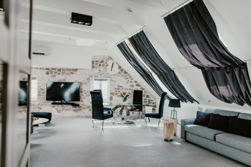 A seating area at Coco Chanel Boutique Apartment