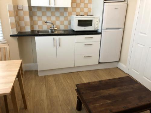 A kitchen or kitchenette at Bagleys Lane