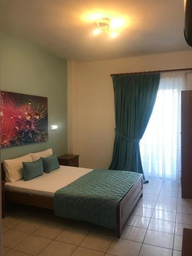 Ένα ή περισσότερα κρεβάτια σε δωμάτιο στο Stella Rooms