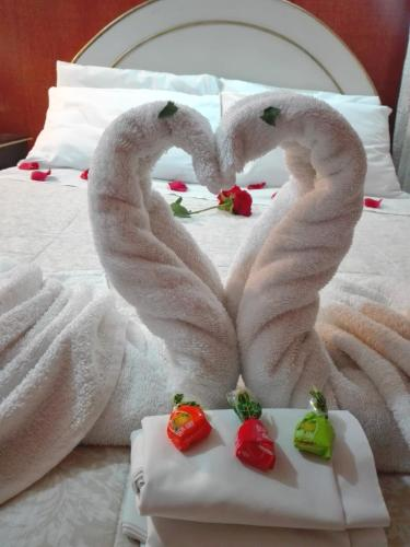 Cama ou camas em um quarto em Puma Hostel Puno