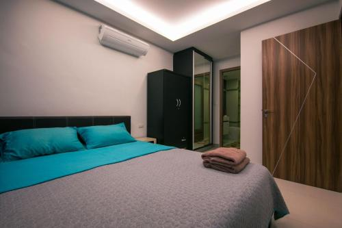 Кровать или кровати в номере Sanctuary Wongamat Apartment 1-Bedroom