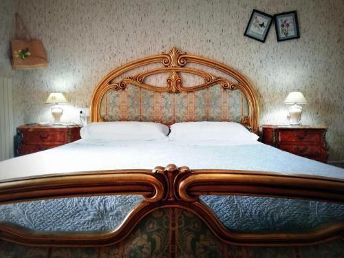 Letto o letti in una camera di Villa Luisia