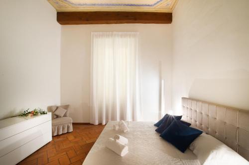 Letto o letti in una camera di Ss. Apostoli 13B - Keys Of Italy