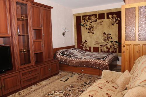 Кровать или кровати в номере Apartment on Gagarina 49