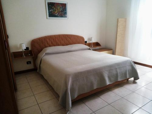 A bed or beds in a room at Casa Nax