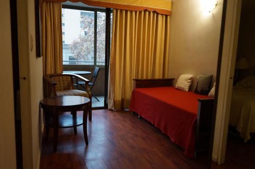 Zona de estar de Encomenderos Apart Hotel