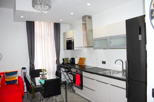 A kitchen or kitchenette at Apartments Brussels Centre