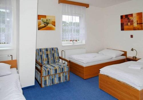 A bed or beds in a room at Chata Lesanka