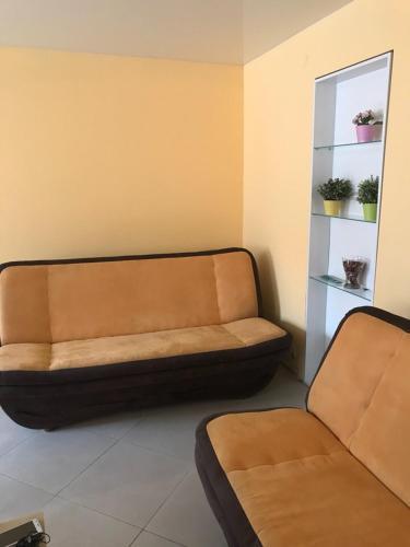 Гостиная зона в Orange Juice Apartment