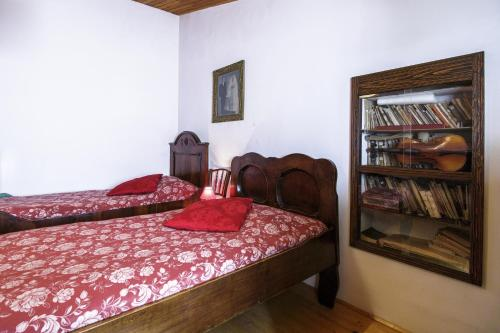 A bed or beds in a room at Antique Central Komiža House Nona Nika
