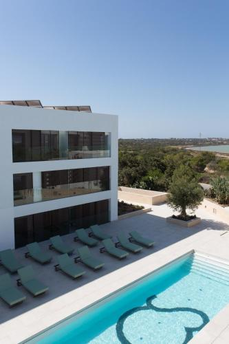 A view of the pool at Sa Pedrera Suites & Spa or nearby