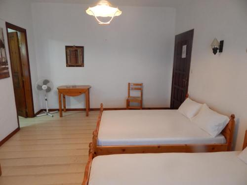 A bed or beds in a room at Ktena Apartments