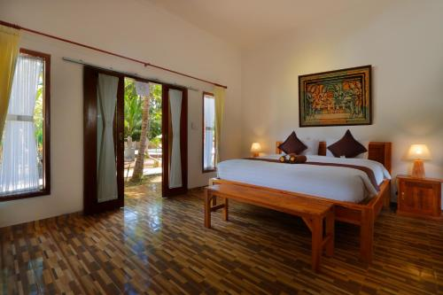 Un ou plusieurs lits dans un hébergement de l'établissement Crystal Bay Villa & Residence