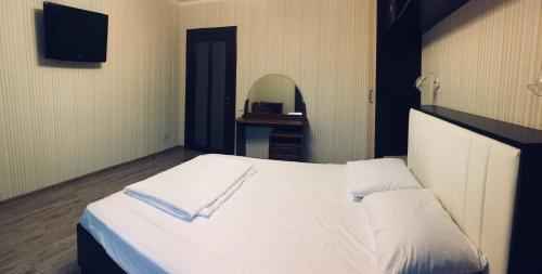 Кровать или кровати в номере Apartment Plus