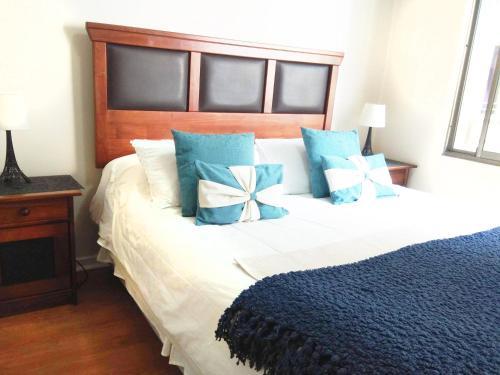 Cama o camas de una habitación en Amunategui Apart 10
