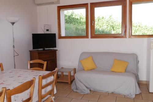 Area soggiorno di Gite Les Roches Bleues