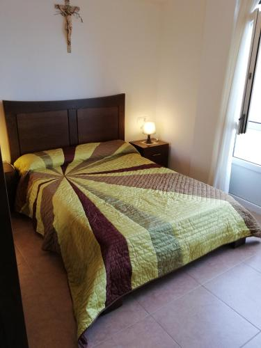 A bed or beds in a room at O Encontro