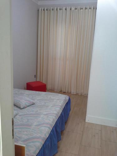 A bed or beds in a room at Sobrado na Cidade de Socorro