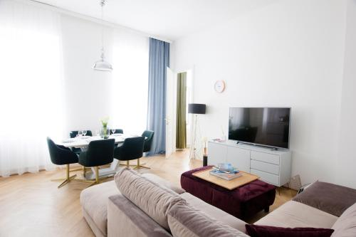 A television and/or entertainment center at The Flats Apartments - Opera
