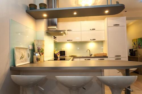 A kitchen or kitchenette at Renata apartment 2BR, near beach