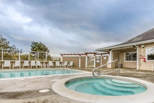 The swimming pool at or near Family Beach Condo