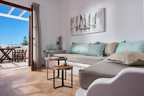 A seating area at Mirabeli Apartments & Suites