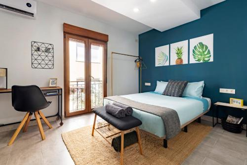 A bed or beds in a room at Oleti Studio Granada