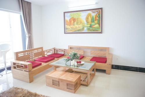 A seating area at Bee & Mi Apartment