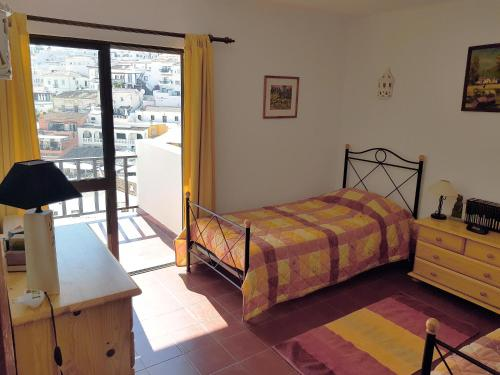 A bed or beds in a room at Carvoeiro Beach Algarve Portugal Praia do Carvoeiro