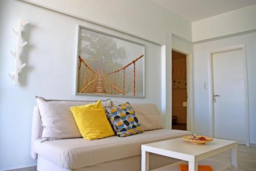 Ein Sitzbereich in der Unterkunft Castello Apartments