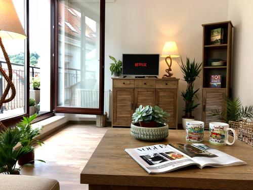A television and/or entertainment center at Heart of the Old Town Apt - Terrace&View