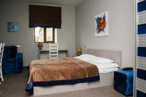 Кровать или кровати в номере Апарт-отель Ямской посад