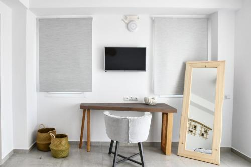 A television and/or entertainment centre at Angelos Boutique Suites