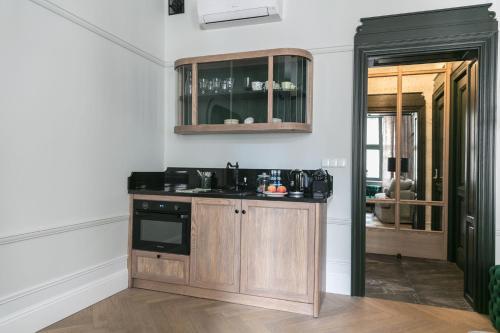 A kitchen or kitchenette at Apartamenty Stary Rynek 25 Toruń