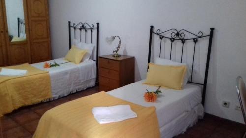 A bed or beds in a room at Casa da Praça Portalegre